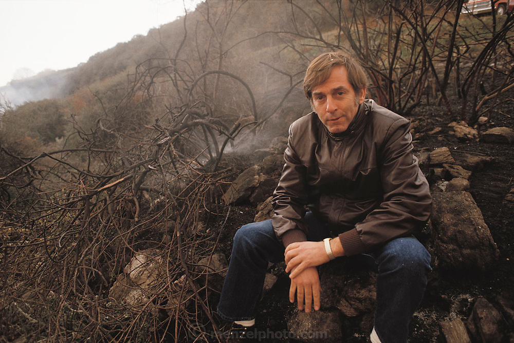 Scientist Richard Turco and Carl Sagan were on the scientific team that devised the concept of nuclear winter. Turco is seen here at the Nuclear Winter test fire: where a canyon outside Los Angeles was deliberately set on fire to study the potential climatic effects of a nuclear war. The nuclear winter theory predicts that smoke from fires burning after a nuclear war would block sunlight, causing a rapid drop in temperature that would trigger serious ecological disturbance. The test burn took place in December 1986 on 500 acres of brush in Lodi Canyon, Los Angeles. Dripping napalm from a helicopter ignited the fire. Ground-based temperature sensors were used to study soil erosion. Various airborne experiments included smoke sampling & high-altitude infrared imaging from a converted U-2 spy plane.