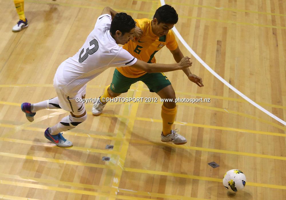 Dylan Manickum of New Zealand is tackled. ASB Trans Tasman Cup, Futsal Whites v Futsal Roos, ASB Stadium, Kohimarama, FSaturday 22 September 2012. Photo: Simon Watts/photosport.co.nz