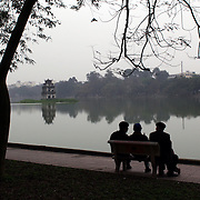 Early morning beside Hoan Kiem Lake, Hanoi, Vietnam, with the Thap Rue Pagoda visible in the distance. Hanoi is the capital of Vietnam and the country's second largest city. Hanoi, Vietnam. 17th March 2012. Photo Tim Clayton
