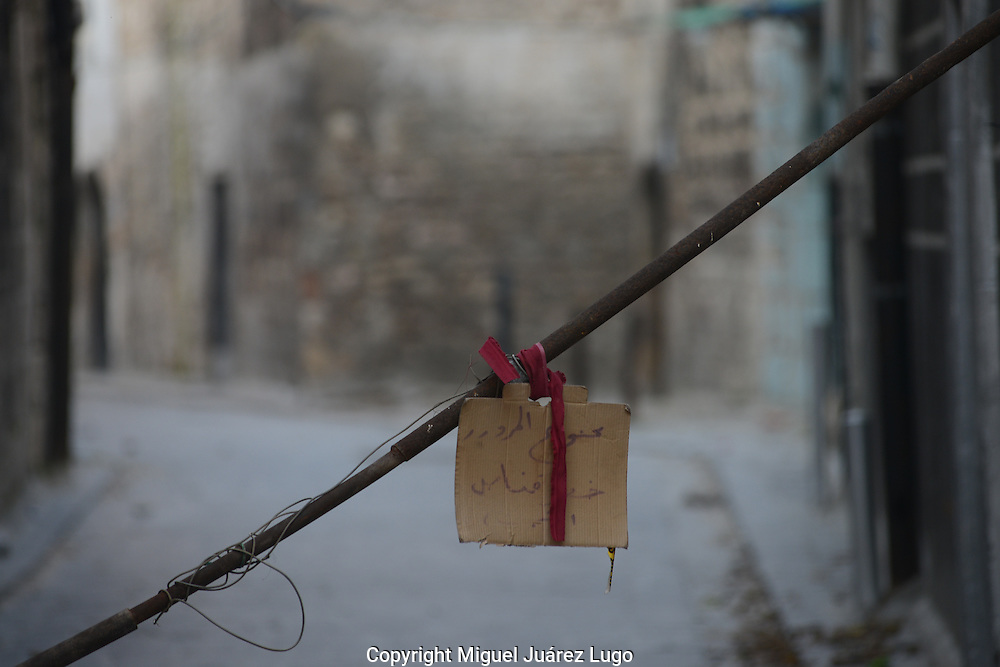 "Aleppo, Syria, January, 2013 - ""Do Not Pass: Danger of Sniper"" reads a handwritten sign along a narrow street in the Old City section of Aleppo. (Photo by Miguel Juárez Lugo)"