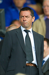 LIVERPOOL, ENGLAND - Sunday, August 30, 2009: Hull City manager Phil Brown watches from the stands as Everton take on Wigan Athletic during the Premiership match at Goodison Park. (Photo by David Rawcliffe/Propaganda)