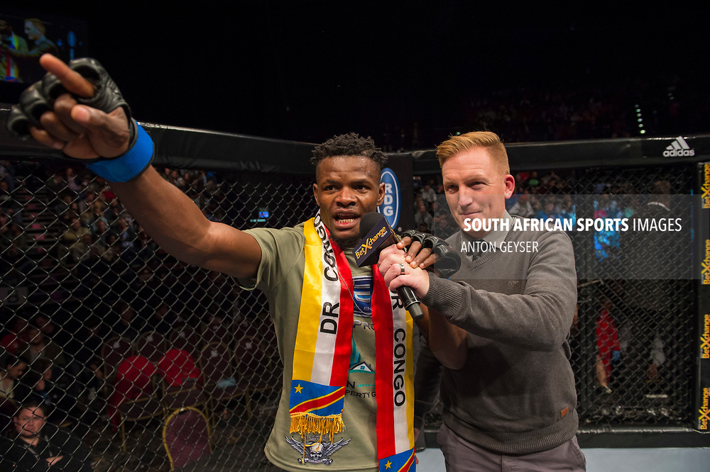 JOHANNESBURG, SOUTH AFRICA - MAY 13: Alain Ilunga celebrates after defeating Barend Nienaber during EFC 59 Fight Night at Carnival City on May 13, 2017 in Johannesburg, South Africa. (Photo by Anton Geyser/EFC Worldwide/Gallo Images)