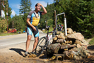 08 September 2013: Robert Murillo of Boulder rinses off at the town of Ward's natural spring, a common stopping point to refill water bottles and cool off during the bicycle ride from the front range city of Boulder to the mountain town of Ward via Old Stage Road and Left Hand Canyon in Boulder, CO. ©Brett Wilhelm