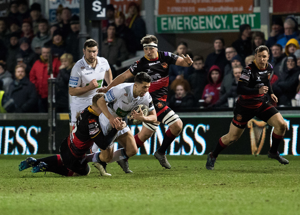 Glasgow Warriors' Adam Hastings is tackled by Dragons' Jack Dixon<br /> <br /> Photographer Simon King/Replay Images<br /> <br /> Guinness PRO14 Round 14 - Dragons v Glasgow Warriors - Friday 9th February 2018 - Rodney Parade - Newport<br /> <br /> World Copyright © Replay Images . All rights reserved. info@replayimages.co.uk - http://replayimages.co.uk