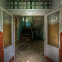 An abandoned Soviet sports hospital in East Germany with double doors