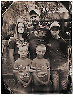 "I had visions of Diane Arbus' iconic identical twins photograph when I passed by Cameron (right) and Dalton with their family at the Waldo Flea Market. Their stepfather Brian Langford, 43, said he and the family, including wife Dana, 27, and son Dillon, 11, where just ""killing the day"" looking at the odds and ends for sale."