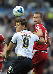 Chris Martin of Derby County challenges for the header with Ben Gibson of Middlesbrough - Mandatory byline: Dougie Allward/JMP - 07966386802 - 18/08/2015 - FOOTBALL - iPro Stadium -Derby,England - Derby County v Middlesbrough - Sky Bet Championship