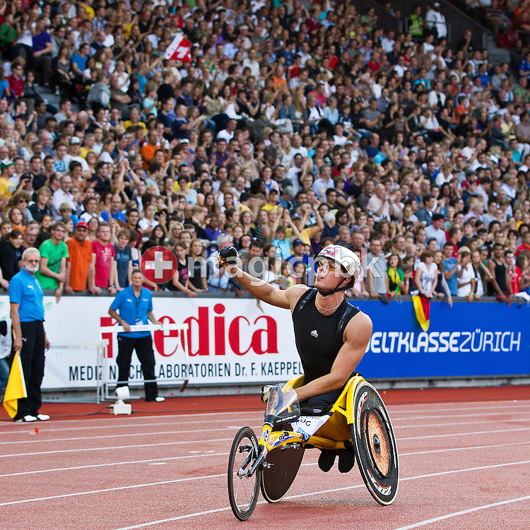 Marcel HUG of Switzerland jubilates on his lap of honor after winning the men's 1500m Wheelchair during the IAAF Diamond League meeting at the Letzigrund Stadium in Zurich, Switzerland, Thursday, Aug. 19, 2010. (Photo by Patrick B. Kraemer / MAGICPBK)