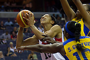 Team USA forward Candace Parker gets fouled during the 2012 USA Women's Basketball Team versus Brazil at Verizon Center in Washington, DC.  July 16, 2012  (Photo by Mark W. Sutton)