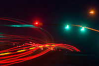 Blurred motion of cars passing under a traffic signal at night, california, usa