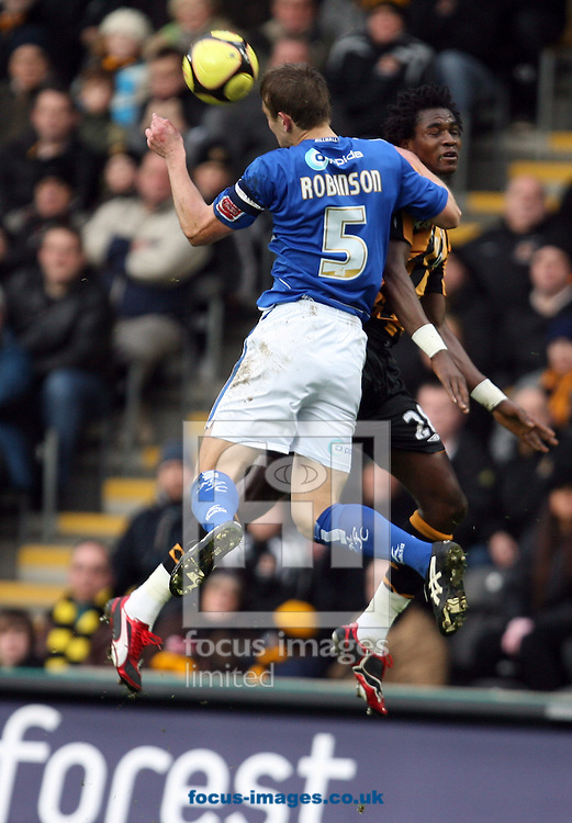 Hull - Saturday, January 24th, 2009: Manucho of Hull City and Paul Robinson of Millwall battle in the air for the ball during the FA Cup fourth round match at the KC Stadium, Hull. (Pic by Darren Walker/Focus Images)