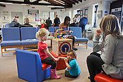 Children play with the toys supplied by PACT at the visitors centre. HMP Nottingham visitors centre run by the Prison Advice and Care Trust, PACT.
