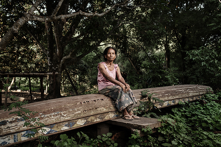 A widow from Kbal Romeas sits on top of a wooden canoe that her husband used for fishing. She now lives with her older brother in a house they'll soon have to leave behind. The village will in fact be flooded by the reservoir of the 400MW Lower Sesan 2 dam, a project carried out by Hydrolancang, a Chinese-state owned company responsible for no less than 7 dams in the upper Mekong region. Stung Treng, northern Cambodia.