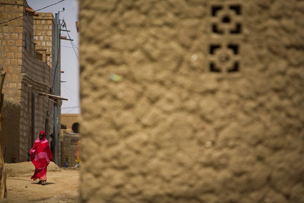 A woman walking on a street in Timbuktu, Mali.