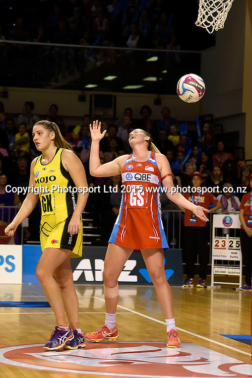 Swifts' Caitlin Thwaites (R is caught out by the half time whistle with Pulse's Te Huinga Reo Selby-Rickit  during the ANZ Championship - Pulse v Swifts netball match at the TSB Arena in Wellington on Saturday the 25th of April 2015. Photo by Marty Melville / www.Photosport.co.nz
