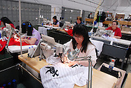 4/3/09 10:51:38 AM -- Easton, PA, U.S.A. -- Barbara Graver, a seamstress at Majestic Athletic sews lettering on the back of a Chicago White Sox jersey April 3, 2009 in Easton, Pennsylvania. White Sox jerseys and gear have experienced a boost in sales with Obama, a White Sox fan, in the White House. -- .Photo by William Thomas Cain,  cainimages.com
