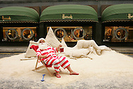 Father Christmas visits Harrods to help launch the Christmas World on the 2nd floor. Father Christmas unveiled a sand sculpture depicting a traditional christmas scene designed by british sand artist Andrew Baynes. The 5ft sculpture has taken over 8 tonnes of sand and 30 hours to sculpt.