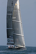 United States team BMW Oracle Racing tests wind and sails at it circles in prestart maneuvers during America's Cup international sailing yacht race; Valencia, Spain.