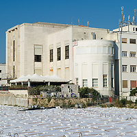 VENICE, ITALY - AUGUST 18: Polythene sheets cover the front of the New Palazzo del Cinema at Lido on August 18, 2011 in Venice, Italy. The works at the new Palazzo del Cinema have stalled after it emerged that more than 15m euros were necessary to remove asbestos from the structure. (Photo by Marco Secchi/Getty Images)