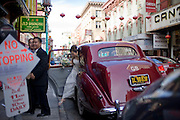 Bride and Groom step out of a Rolls Royce for their Wedding reception in Chinatown, San Francisco.