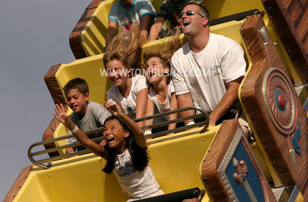 Children and an adult enjoy a ride at the Fantasy Island Amusement Park in Beach Haven on Long Beach Island, N.J., on Aug. 26, 2005.........