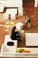 Businessman and Businesswoman in Office Lobby