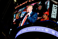 Hershey, PA, USA - Dec. 15, 2016; President-Elect Donald Trump appears on the JumboTron as he gives a speech at a post-election Thank You Tour event with Vice-President-Elect Mike Pence, at the Giant Center in Hershey, PA.