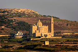 MALTA GOZO TA'PINU 22JUL06 - General view of the Ta' Pinu Basilica located in the open countryside. The church was built between 1920 and 1932 to accommodate the increased number of pilgrims that flock to the place to this day. A chapel had existed in this location since the medieval era and the place gained notoriety from 1883 when a local fieldworker heard a disembodied voice instructing her to recite three Hail-Mary's...jre/Photo by Jiri Rezac..© Jiri Rezac 2006..Contact: +44 (0) 7050 110 417.Mobile: +44 (0) 7801 337 683.Office: +44 (0) 20 8968 9635..Email: jiri@jirirezac.com.Web: www.jirirezac.com