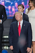 GOP Presidential candidate Donald Trump stands on stage as balloons and confetti drop after accepting the party nomination for president on the final day of the Republican National Convention July 21, 2016 in Cleveland, Ohio.