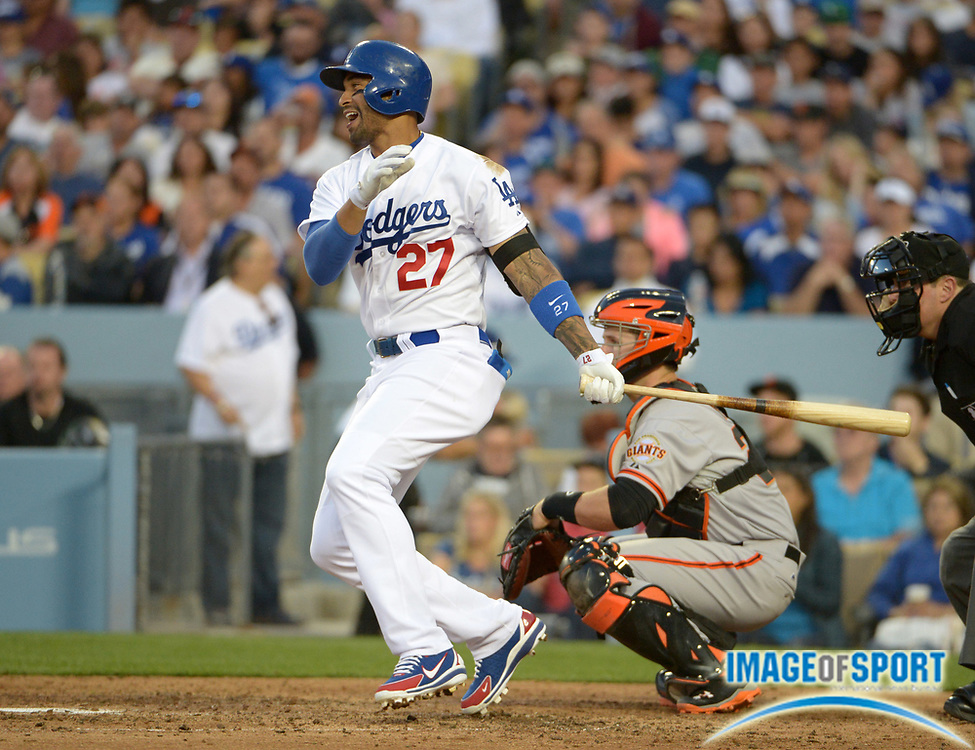 Apr 6, 2014; Los Angeles, CA, USA; Los Angeles Dodgers center fielder Matt Kemp (27) as San Francisco Giants catcher Buster Posey watches at Dodger Stadium. The Dodgers defeated the Giants 6-2.