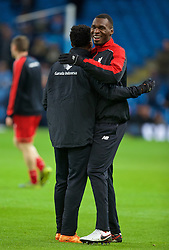 MANCHESTER, ENGLAND - Saturday, November 21, 2015: Liverpool's Christian Benteke and Daniel Sturridge embrace before the Premier League match against Manchester City at the City of Manchester Stadium. (Pic by David Rawcliffe/Propaganda)