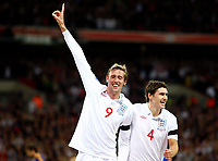England's Peter Crouch celebrates his goal  World Cup Qualifer England v Ukraine at Wembley Stadium 01/04/2009. Credit  Colorsport / Kieran Galvin