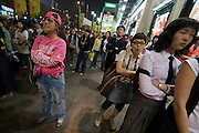 Dongdaemun Market. Shoppers watching dance show in front of Migliore shopping center.