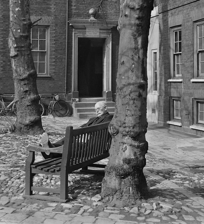 Man sleeping on bench at Staple Inn, London, 1939