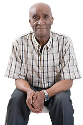 Portrait of an older man sitting on a chair,