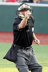 11 July 2012:  Homeplate umpire Dave Logan calls a strike during the Frontier League All Star Baseball game at Corn Crib Stadium on the campus of Heartland Community College in Normal Illinois