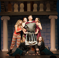 """Miles Gloriosus (Christian Ayer) is surrounded by Panacea (Cordelia Penney), Vibrata (Alexa Dembiec), Tintinabula (Kayla Zarella) and The Geminae (Victoria Brasil and Savannah Plummer) during dress rehearsal for Gilford High School's production of """"A Funny Thing Happened on the Way to the Forum"""" Tuesday evening.   (Karen Bobotas/for the Laconia Daily Sun)"""