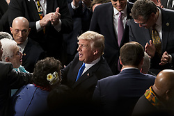 January 30, 2018 - Washington, District Of Columbia, U.S. - United States President DONALD J. TRUMP greets members of Congress as he enters the Senate Chamber prior to delivering the State Of The Union Address at the United States Capitol. (Credit Image: © Alex Edelman via ZUMA Wire)
