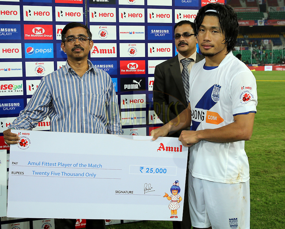 Singam Subash Singh of Mumbai City FC recives Amul fittest player of the match award during the presentation of the  match 15 of the Hero Indian Super League between Chennaiyin FC and Mumbai City FC held at the Jawaharlal Nehru Stadium, Chennai, India on the 28th October 2014.<br /> <br /> Photo by:  Sandeep Shetty/ ISL/ SPORTZPICS