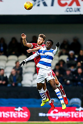 Nathan Baker of Bristol City and Idrissa Sylla of Queens Park Rangers compete in the air - Rogan/JMP - 23/12/2017 - Loftus Road - London, England - Queens Park Rangers v Bristol City - Sky Bet Championship.