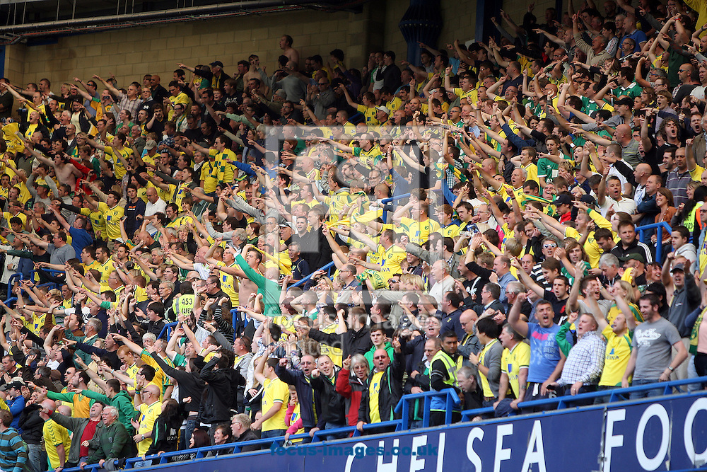 The traveling Norwich fans during the Barclays Premier League match at Stamford Bridge stadium, London...Picture by Paul Chesterton/Focus Images Ltd.  07904 640267.27/8/11