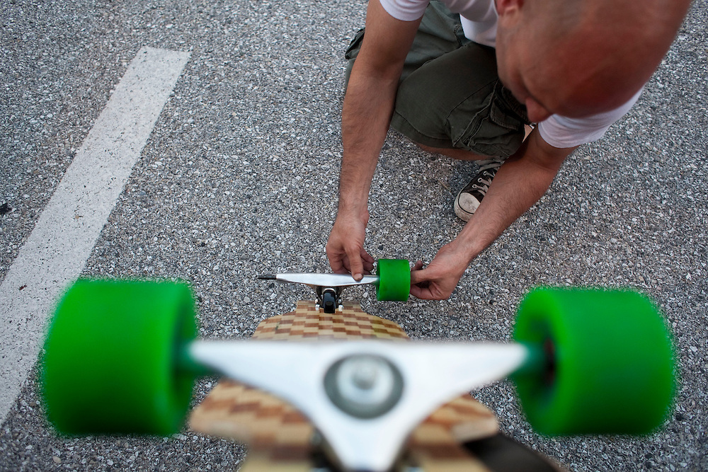 Scott Frias, 43, prepares his deck for an evening's ride in parking garages in Towson, MD. Surreptitiously skating in parking garages after the cars, and the people, have left for the evening leaves a safe patch of asphalt for the older skaters looking for a long, sweet ride.