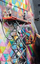 © Licensed to London News Pictures.  29/07/2017; Bristol, UK. Upfest 2017. A giant mural in progress of John Lennon created by Brazilian artist Kobra on the side of the Tobacco Factory for Upfest, Europe's largest street art festival held annually in Bedminster, Bristol. The festival officially runs from 29 - 31 July with over 350 artists live painting in 37 locations including this Ashton Gate stadium, home of Bristol City FC. Picture credit : Simon Chapman/LNP