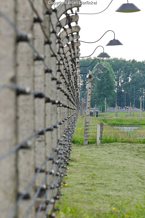 The barbed wire, electric fence in Auschwitz-Birkenau Concentration Camp in Poland on Tuesday July 5th 2011.  (Photo by Brian Garfinkel)