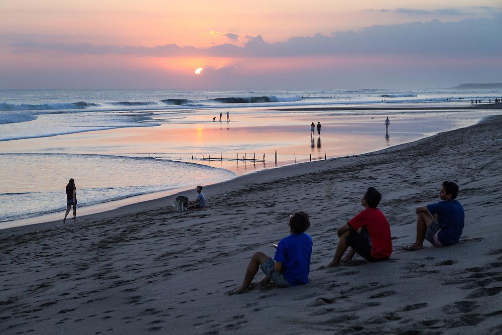 Flying a kite during sunset at Kayu Putih beach in Canggu.