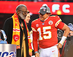 Jan 19, 2020; Kansas City, Missouri, USA; Kansas City Chiefs quarterback Patrick Mahomes (15) celebrates with former player Bobby Bell after the AFC Championship Game against the Tennessee Titans at Arrowhead Stadium. Mandatory Credit: Denny Medley-USA TODAY Sports
