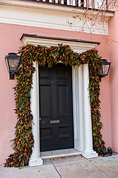 December 21, 2017 - Charleston, South Carolina, United States of America - Traditional low country style magnolia leaf Christmas roping decorates a historic home along the Battery in Charleston, SC. (Credit Image: © Richard Ellis via ZUMA Wire)