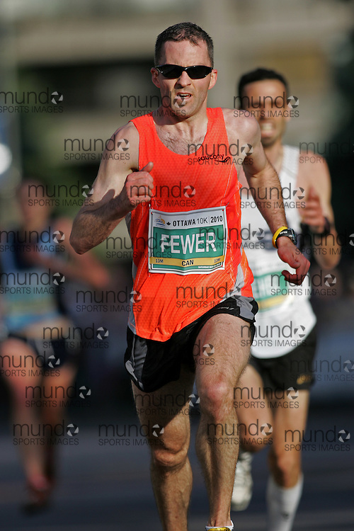 (Ottawa, ON --- May 29, 2010) COLIN FEWER running in the 10km race during the Ottawa Race Weekend. Photograph copyright Sean Burges / Mundo Sport Images