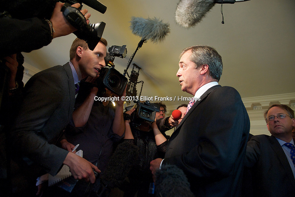 UKIP Leader Nigel Farage speaks to the media after his Keynote Speech at UKIP's annual conference, Central Hall, Westminster, London, United Kingdom. Friday, 20th September 2013. Picture by Elliot Franks / i-Images