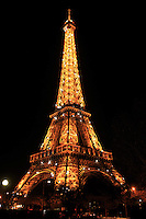 The Eiffel Tower lit up at night in Paris, France.